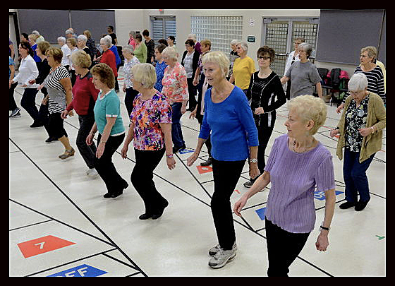 Adult dance students have fun while learning to Line Dance at The Dance Element