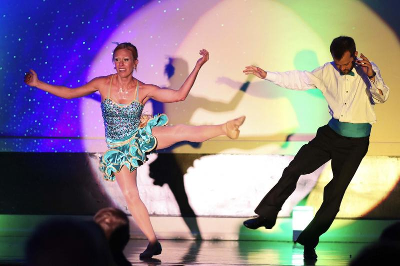 Ashley Barnes performs with Robby Collins in Dancing with the Wilmington Stars